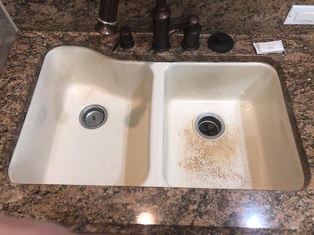 White sink with worn finish