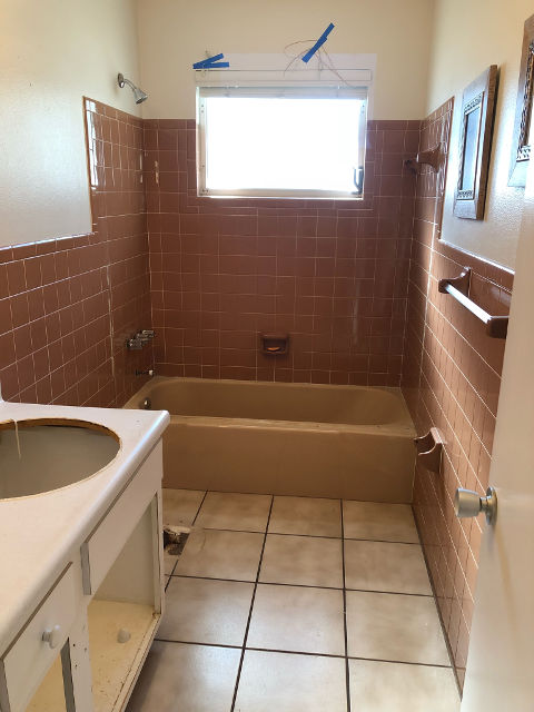 Full bath and shower before being refinished