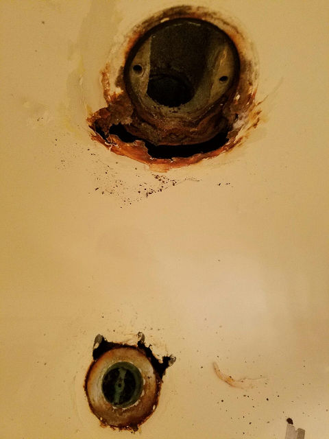 Bath tub overflow and drain with rust damage