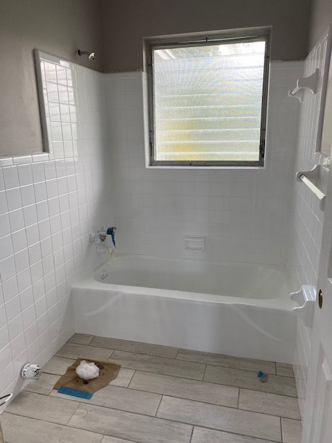 Pink shower tile refinished white