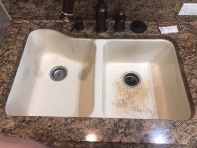 White sink with worn finish