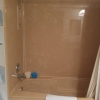 Old brown shower walls need refinishing