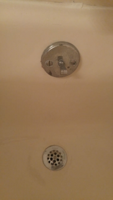 Refinished tub drain and overflow look like new