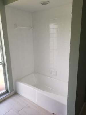 Newly reglazed white tub.shower