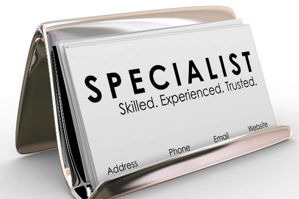 specialist business card in chrome holder