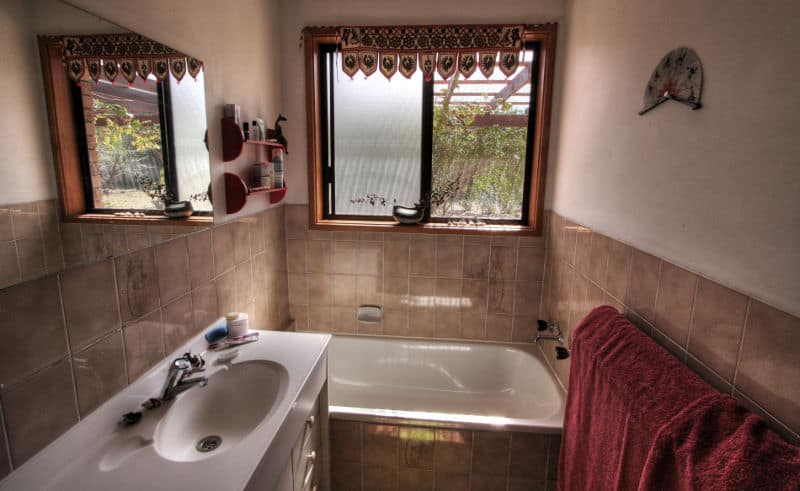 small bathroom in brown decor