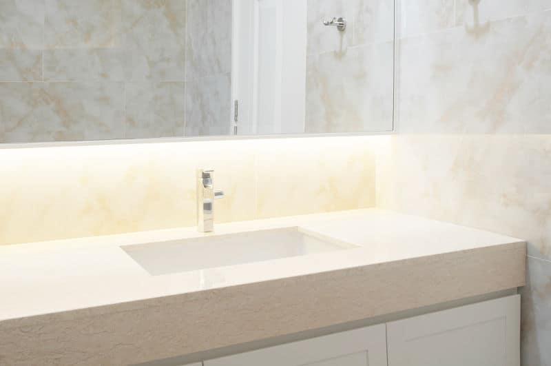 beige bathroom vanity counter top and sink
